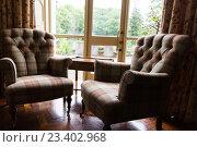 Купить «close up of vintage armchairs and table in hotel», фото № 23402968, снято 23 июня 2016 г. (c) Syda Productions / Фотобанк Лори