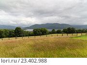 Купить «view to lake and farmland at connemara in ireland», фото № 23402988, снято 24 июня 2016 г. (c) Syda Productions / Фотобанк Лори