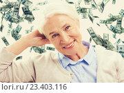 Купить «happy senior woman face over violet background», фото № 23403116, снято 10 июля 2015 г. (c) Syda Productions / Фотобанк Лори