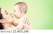 Купить «happy mother kissing adorable baby», фото № 23403248, снято 22 декабря 2007 г. (c) Syda Productions / Фотобанк Лори