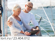senior couple with tablet pc on sail boat or yacht. Стоковое фото, фотограф Syda Productions / Фотобанк Лори