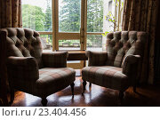 Купить «close up of vintage armchairs and table in hotel», фото № 23404456, снято 23 июня 2016 г. (c) Syda Productions / Фотобанк Лори
