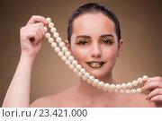 Купить «Woman with pearl necklace isolated on white», фото № 23421000, снято 19 июля 2016 г. (c) Elnur / Фотобанк Лори