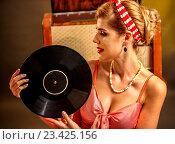 Купить «Girl in style holding vinyl record.», фото № 23425156, снято 12 августа 2016 г. (c) Gennadiy Poznyakov / Фотобанк Лори