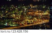Купить «Вид на ночной азиатский город. Движение автомобилей по автомагистрали», видеоролик № 23428156, снято 24 октября 2014 г. (c) Elnur / Фотобанк Лори