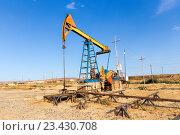 Купить «Добыча нефти. Нефтяная качалка, насос», фото № 23430708, снято 24 сентября 2015 г. (c) Евгений Ткачёв / Фотобанк Лори