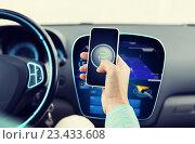 Купить «hands with start engine icon on smartphone in car», фото № 23433608, снято 17 июля 2015 г. (c) Syda Productions / Фотобанк Лори