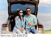 Купить «happy couple with coffee at hatchback car trunk», фото № 23434012, снято 12 июня 2016 г. (c) Syda Productions / Фотобанк Лори