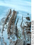 Купить «Twilight ocean coast with ribbed stratiform rock.», фото № 23438928, снято 7 мая 2016 г. (c) Юрий Брыкайло / Фотобанк Лори