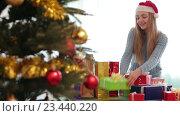 Купить «Happy girl in Santa hat», видеоролик № 23440220, снято 11 февраля 2016 г. (c) Яков Филимонов / Фотобанк Лори