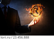 Купить «Copyright symbol burning in fire . Mixed media», фото № 23456888, снято 4 октября 2014 г. (c) Sergey Nivens / Фотобанк Лори