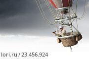 Купить «Man traveling in aerostat . Mixed media», фото № 23456924, снято 25 марта 2014 г. (c) Sergey Nivens / Фотобанк Лори