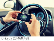 Купить «hands with start engine icon on smartphone in car», фото № 23460488, снято 17 июля 2015 г. (c) Syda Productions / Фотобанк Лори