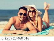 Купить «happy couple in swimwear lying on summer beach», фото № 23460516, снято 11 августа 2015 г. (c) Syda Productions / Фотобанк Лори