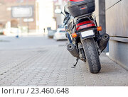 Купить «close up of motorcycle parked on city street», фото № 23460648, снято 12 мая 2016 г. (c) Syda Productions / Фотобанк Лори