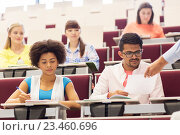 Купить «international students with test on lecture», фото № 23460696, снято 19 июня 2016 г. (c) Syda Productions / Фотобанк Лори