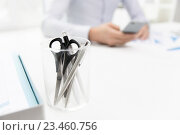 Купить «close up of cup with scissors and pens at office», фото № 23460756, снято 18 июня 2015 г. (c) Syda Productions / Фотобанк Лори