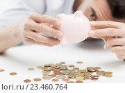 Купить «close up of man pouring coins from piggy bank», фото № 23460764, снято 18 июня 2015 г. (c) Syda Productions / Фотобанк Лори