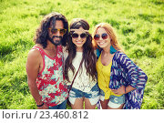 Купить «smiling young hippie friends on green field», фото № 23460812, снято 27 августа 2015 г. (c) Syda Productions / Фотобанк Лори
