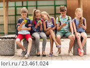 Купить «elementary school students with smartphones», фото № 23461024, снято 24 июля 2016 г. (c) Syda Productions / Фотобанк Лори