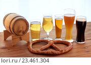 Купить «close up of beer glasses, barrel and pretzel», фото № 23461304, снято 22 июля 2016 г. (c) Syda Productions / Фотобанк Лори