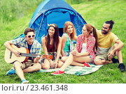 Купить «happy friends with drinks and guitar at camping», фото № 23461348, снято 25 июля 2015 г. (c) Syda Productions / Фотобанк Лори