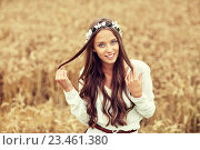 Купить «smiling young hippie woman on cereal field», фото № 23461380, снято 27 августа 2015 г. (c) Syda Productions / Фотобанк Лори
