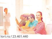 Купить «female student with classmates in computer class», фото № 23461440, снято 29 марта 2014 г. (c) Syda Productions / Фотобанк Лори