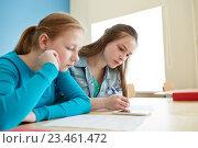 Купить «student girls with smartphone writing school test», фото № 23461472, снято 22 апреля 2016 г. (c) Syda Productions / Фотобанк Лори