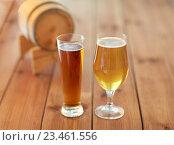 Купить «close up of different beers in glasses on table», фото № 23461556, снято 22 июля 2016 г. (c) Syda Productions / Фотобанк Лори