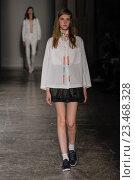 Купить «MILAN, ITALY - SEPTEMBER 28: A model walks the runway during the Arthur Arbesser fashion show as part of Milan Fashion Week Spring/Summer 2016 on September 28, 2015 in Milan, Italy.», фото № 23468328, снято 28 сентября 2015 г. (c) Anton Oparin / Фотобанк Лори