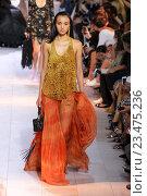 Купить «MILAN, ITALY - SEPTEMBER 26: A model walks the runway during the Roberto Cavalli fashion show as part of Milan Fashion Week Spring/Summer 2016 on September 26, 2015 in Milan, Italy.», фото № 23475236, снято 26 сентября 2015 г. (c) Anton Oparin / Фотобанк Лори
