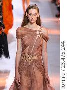 Купить «MILAN, ITALY - SEPTEMBER 26: A model walks the runway during the Roberto Cavalli fashion show as part of Milan Fashion Week Spring/Summer 2016 on September 26, 2015 in Milan, Italy.», фото № 23475244, снято 26 сентября 2015 г. (c) Anton Oparin / Фотобанк Лори