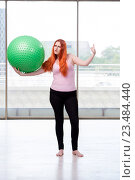 Купить «Young woman exercising with swiss ball in health concept», фото № 23484440, снято 17 июня 2016 г. (c) Elnur / Фотобанк Лори