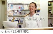 Купить «Pharmacist checking a medicine in pharmacy», видеоролик № 23487892, снято 5 апреля 2020 г. (c) Wavebreak Media / Фотобанк Лори