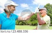 Купить «Two happy golfers giving high five», видеоролик № 23488336, снято 22 июля 2019 г. (c) Wavebreak Media / Фотобанк Лори