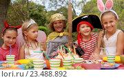 Купить «Group of kids in various costumes having breakfast», видеоролик № 23488892, снято 16 июля 2019 г. (c) Wavebreak Media / Фотобанк Лори