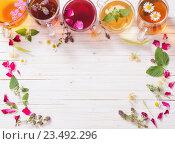 Купить «herbal tea on a white wooden background», фото № 23492296, снято 5 июля 2016 г. (c) Майя Крученкова / Фотобанк Лори