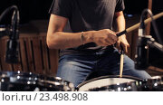 Купить «male musician playing drums and cymbals at concert», видеоролик № 23498908, снято 25 августа 2016 г. (c) Syda Productions / Фотобанк Лори