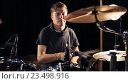Купить «male musician playing drums and cymbals at concert», видеоролик № 23498916, снято 25 августа 2016 г. (c) Syda Productions / Фотобанк Лори