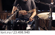 Купить «male musician playing drums and cymbals at concert», видеоролик № 23498940, снято 25 августа 2016 г. (c) Syda Productions / Фотобанк Лори