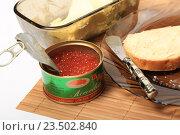 Купить «Белый хлеб с маслом на тарелке, нож и красная икра в банке», эксклюзивное фото № 23502840, снято 8 сентября 2016 г. (c) Яна Королёва / Фотобанк Лори