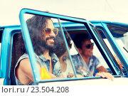 Купить «smiling young hippie friends in minivan car», фото № 23504208, снято 27 августа 2015 г. (c) Syda Productions / Фотобанк Лори