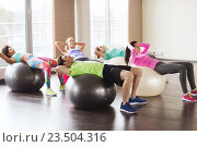 Купить «happy people flexing abdominal muscles on fitball», фото № 23504316, снято 5 апреля 2015 г. (c) Syda Productions / Фотобанк Лори