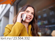 Купить «smiling young woman or girl calling on smartphone», фото № 23504332, снято 12 мая 2016 г. (c) Syda Productions / Фотобанк Лори