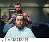 Купить «Hipster in barber shop», фото № 23513196, снято 23 марта 2016 г. (c) Raev Denis / Фотобанк Лори