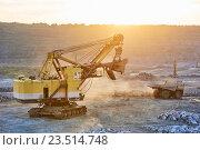 Купить «Mining. excavator and dump truck in granite or iron opencast», фото № 23514748, снято 8 сентября 2016 г. (c) Дмитрий Калиновский / Фотобанк Лори