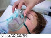 Купить «Nurse placing an oxygen mask on the face of a patient», фото № 23522796, снято 16 декабря 2018 г. (c) Wavebreak Media / Фотобанк Лори