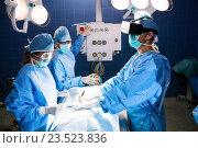 Купить «Surgeons performing operation in operation room», фото № 23523836, снято 2 июля 2016 г. (c) Wavebreak Media / Фотобанк Лори