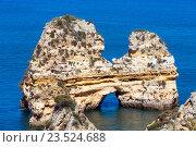 Купить «Yellow cliff near coast (Lagos, Algarve, Portugal).», фото № 23524688, снято 25 мая 2016 г. (c) Юрий Брыкайло / Фотобанк Лори